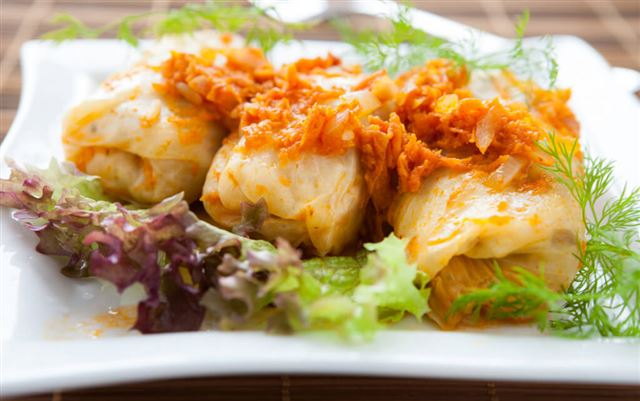 stuffed cabbage with carrot sauce