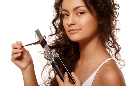 Beauty portrait with curling iron