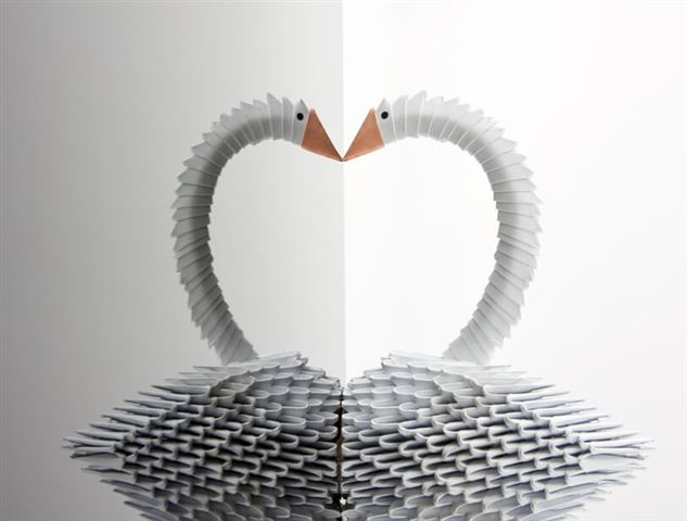 White origami swan with reflection