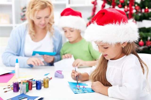 Family making seasonal greeting cards together