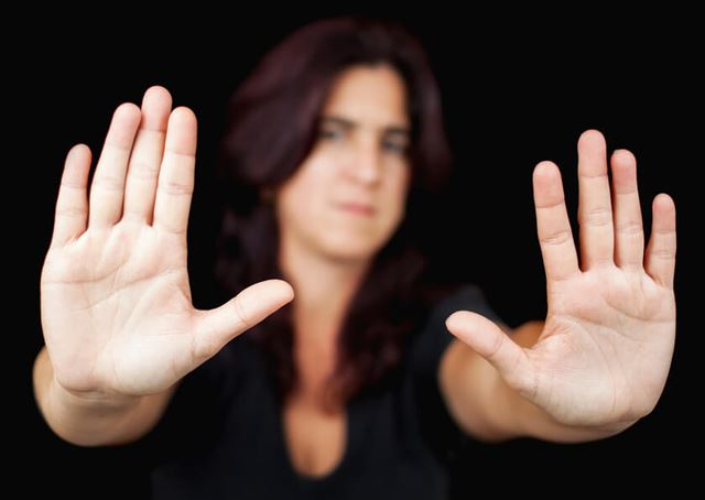 Woman with her hands signaling to stop