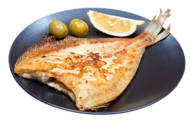 fried sole fish on white background