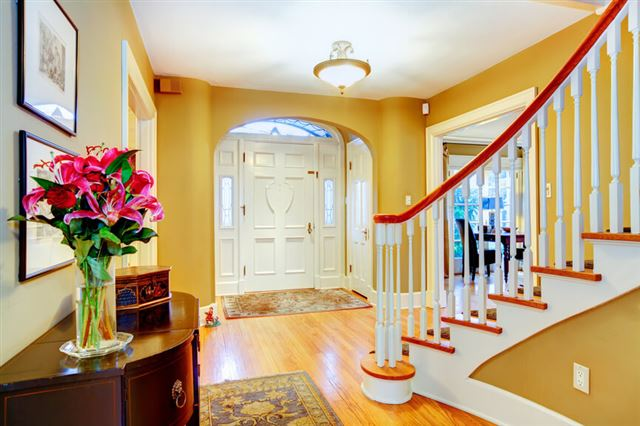 Bright yellow and white entrance hall