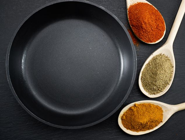 frying pan and various spices