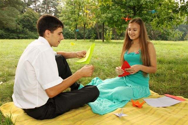 couple making origami