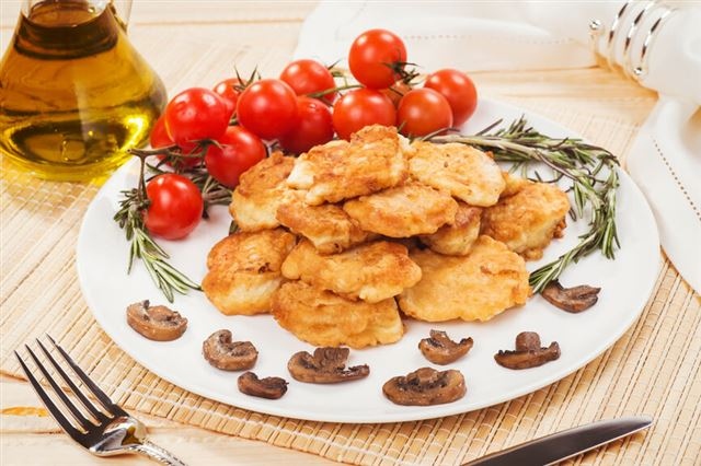 Fish in batter with fried mushrooms