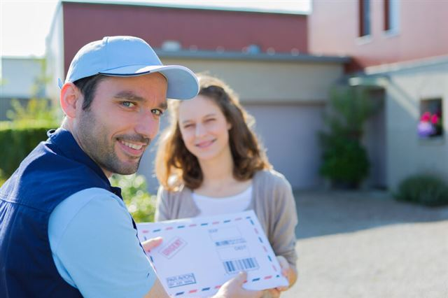 Delivery man handing over a registered mail