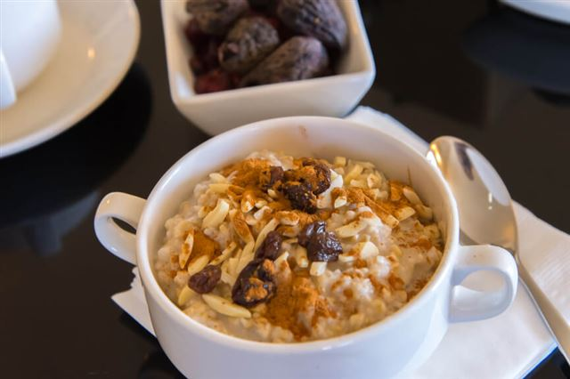 coffee and oatmeal with dried fruit  healthy breakfast setting