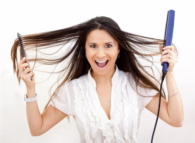 Woman with hair straightener