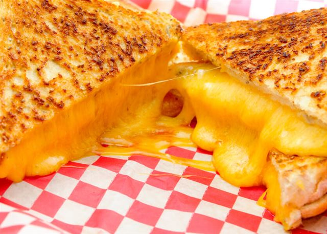 decadent grilled cheese sandwiches with oozing cheese running ou