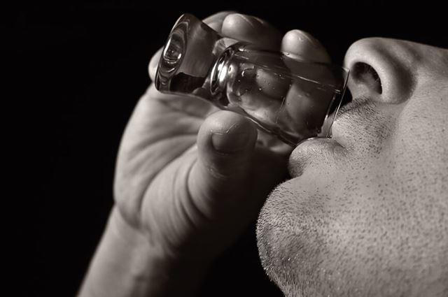 Man drink vodka.